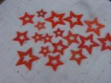 Sterne aus Holz in Orange